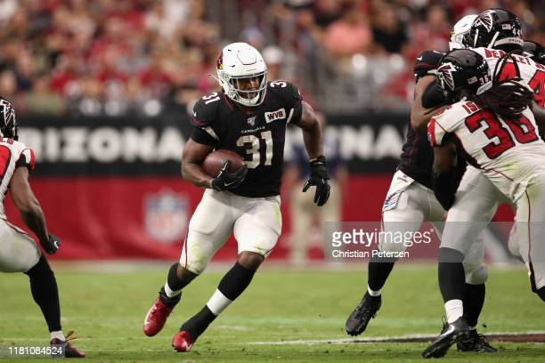Running back David Johnson of the Arizona Cardinals rushes the football against the Atlanta Falcons during the NFL game at State Farm Stadium on...