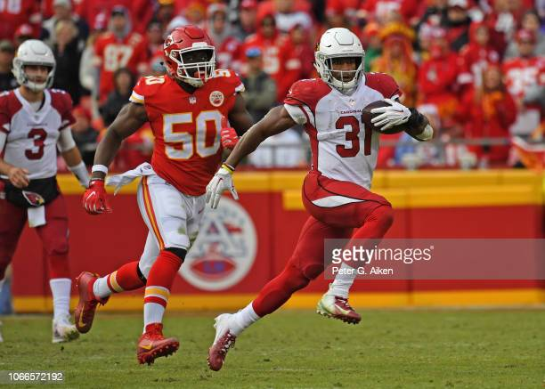 Running back David Johnson of the Arizona Cardinals rushes up field past outside linebacker Justin Houston of the Kansas City Chiefs during the...