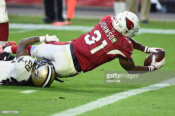 Running back David Johnson of the Arizona Cardinals scores a seven yard touchdown against cornerback BW Webb of the New Orleans Saints in the fourth...
