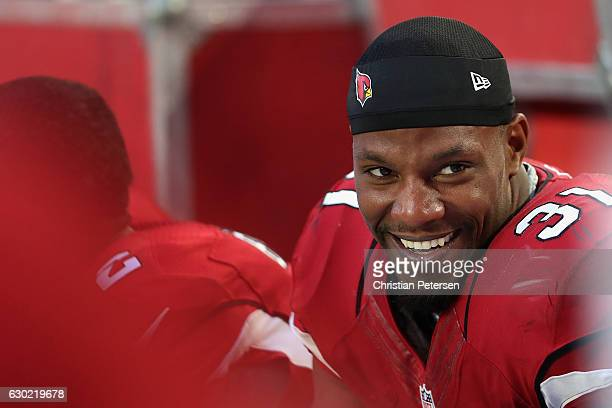 Running back David Johnson of the Arizona Cardinals smiles while sitting on the bench during the NFL game against the New Orleans Saints at the...