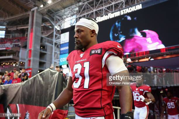 Running back David Johnson of the Arizona Cardinals walks onto the field before the NFL game against the Los Angeles Rams at State Farm Stadium on...