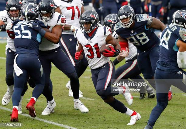 Running back David Johnson of the Houston Texans runs with the ball in the second half of their game at Nissan Stadium on October 18, 2020 in...