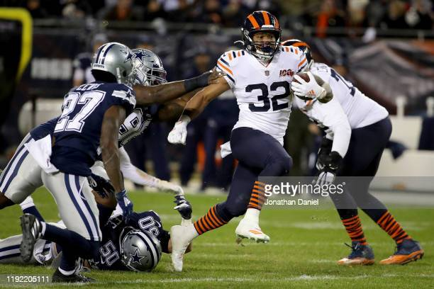 Running back David Montgomery of the Chicago Bears carries the ball against the defense of the Dallas Cowboys during the game at Soldier Field on...