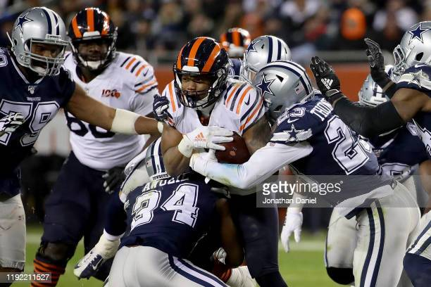 Running back David Montgomery of the Chicago Bears is tackled by the defense of the Dallas Cowboys during the game at Soldier Field on December 05...