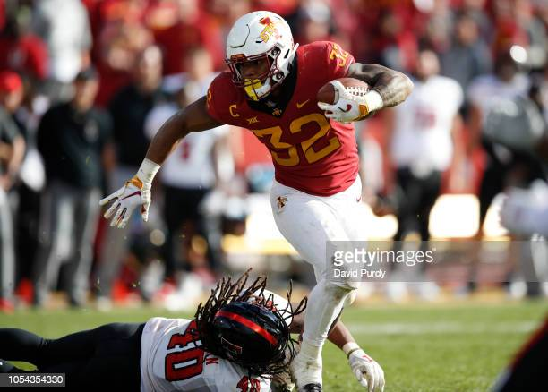 Running back David Montgomery of the Iowa State Cyclones breaks away from linebacker Dakota Allen of the Texas Tech Red Raiders while rising for...