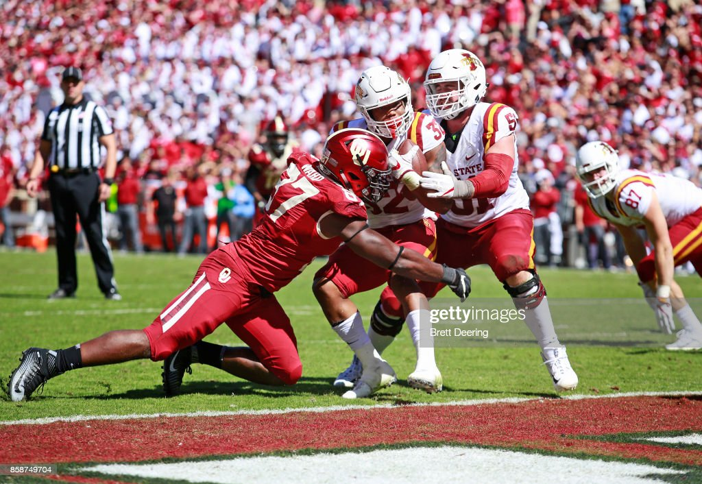 Running back David Montgomery #32 of the Iowa State Cyclones is hit by defensive end D.J. Ward #87 of the Oklahoma Sooners trying to get out of the end zone on long yardage at Gaylord Family Oklahoma Memorial Stadium on October 7, 2017 in Norman, Oklahoma. Iowa State defeated Oklahoma 38-31.
