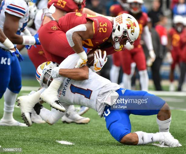 Running back David Montgomery of the Iowa State Cyclones is tackled by safety Bryce Torneden of the Kansas Jayhawks in the first quarter at Memorial...