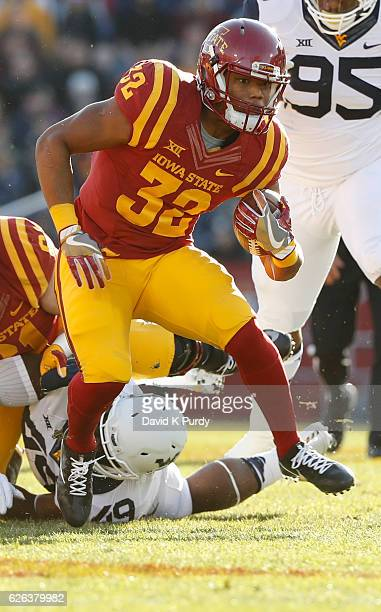 Running back David Montgomery of the Iowa State Cyclones rushes for yards in the first half of play against the West Virginia Mountaineers at Jack...