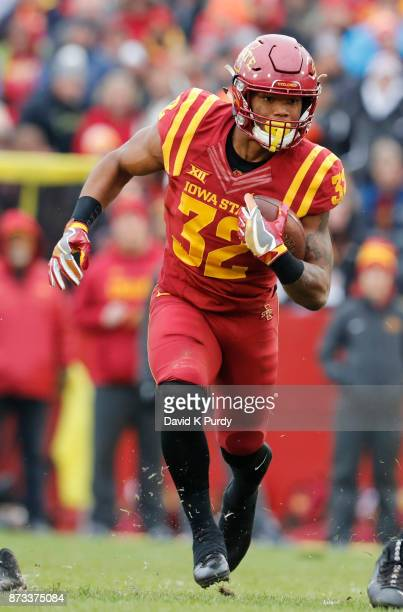 Running back David Montgomery of the Iowa State Cyclones rushes for yards in the first half of play against the Oklahoma State Cowboys at Jack Trice...