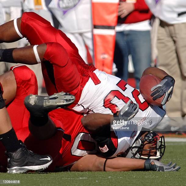 Running back David Peeples is tackled hard ny Utahs Paul Solia at Rice-Eccles Stadium, in Salt Lake City, Utah, Saturday Oct. 28, 2006. Utah defeated...