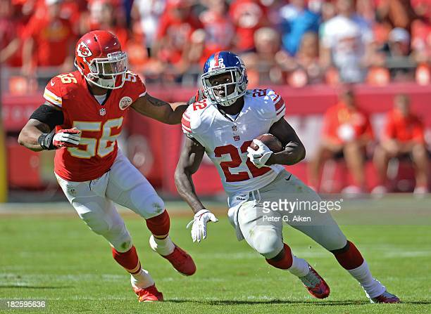 Running back David Wilson of the New York Giants rushes up field against linebacker Derrick Johnson of the Kansas City Chiefs during the second half...