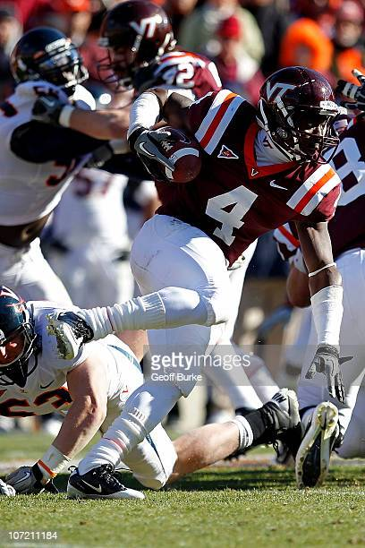 Running back David Wilson of the Virginia Tech Hokies runs with the ball against the Virginia Cavaliers at Lane Stadium on November 27 2010 in...
