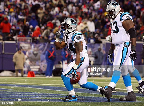 Running back DeAngelo Williams of the Carolina Panthers celebrates after scoring a touchdown against the New York Giants on December 21 2008 at...