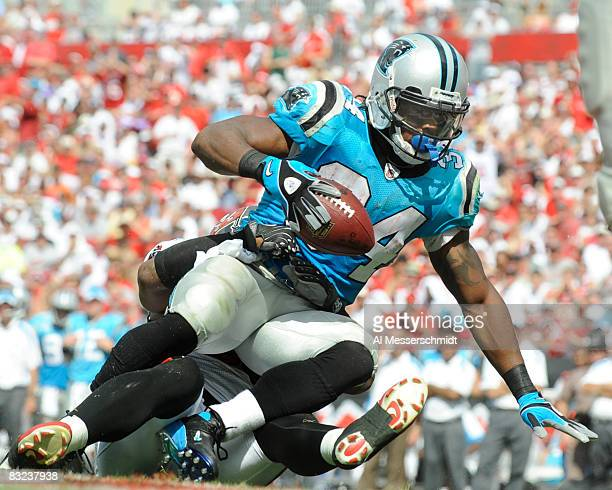 Running back DeAngelo Williams of the Carolina Panthers rushes upfield against the Tampa Bay Buccaneers at Raymond James Stadium on October 12 2008...