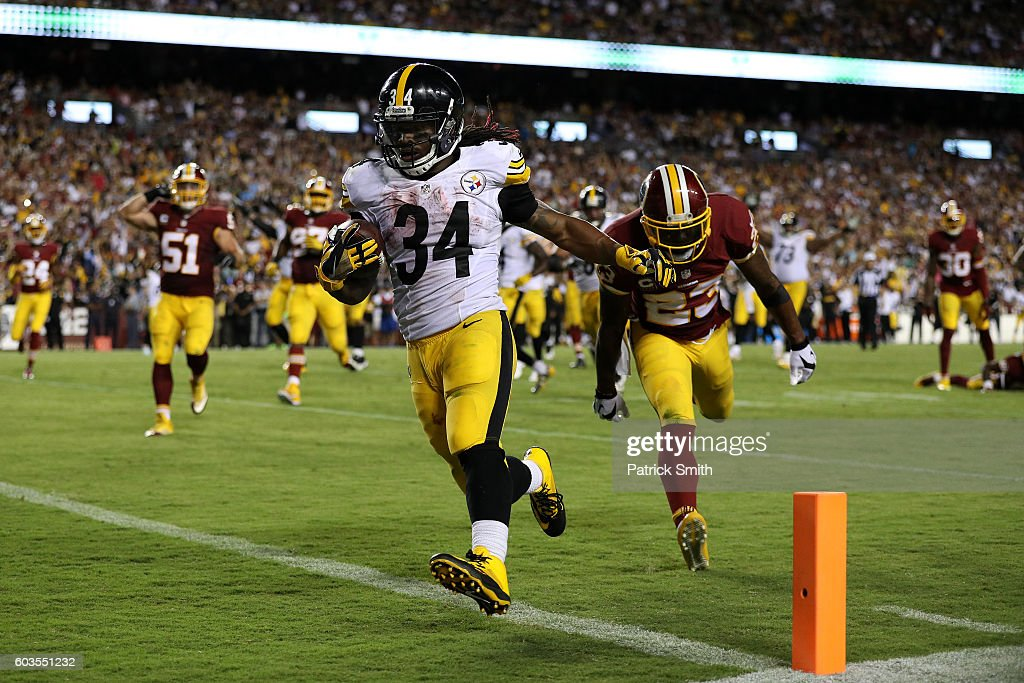 Running back DeAngelo Williams #34 of the Pittsburgh Steelers scores a fourth quarter touchdown past strong safety DeAngelo Hall #23 of the Washington Redskins at FedExField on September 12, 2016 in Landover, Maryland.