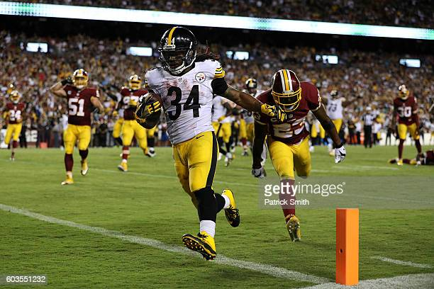 Running back DeAngelo Williams of the Pittsburgh Steelers scores a fourth quarter touchdown past strong safety DeAngelo Hall of the Washington...