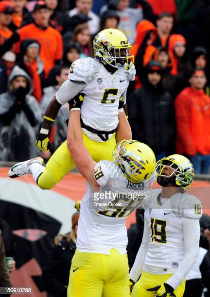 Running back De'Anthony Thomas is lifted into the air by offensive linesman James Euscher of the Oregon Ducks after scoring a touchdown as wide...