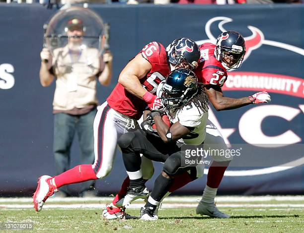 Running back Deji Karim of the Jacksonville Jaguars takes a hardhit from linebacker Brian Cushing of the Houston Texans at Reliant Stadium on October...