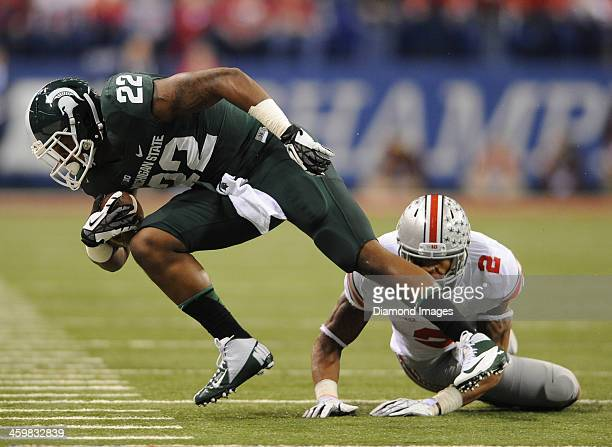 Running back Delton Williams of the Michigan State Spartans is tackled by linebacker Ryan Shazier of the Ohio State Buckeyes during a game against...