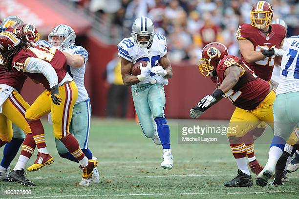 Running back DeMarco Murray of the Dallas Cowboys runs with the ball in the first quarter during a NFL football game against the Washington Redskins...