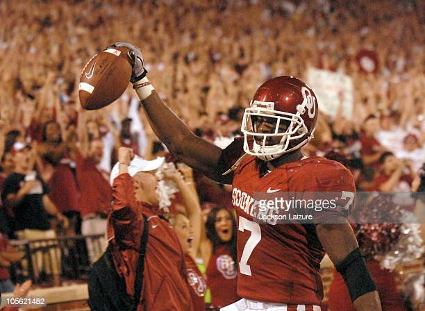 Running back DeMarco Murray of the Oklahoma Sooners holds up the ball after setting the alltime Sooners touchdown record against the Iowa State...