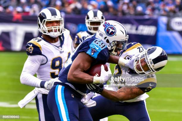 Running Back DeMarco Murray of the Tennessee Titans carries the ball against Corner Back Trumaine Johnson of the Los Angeles Rams at Nissan Stadium...