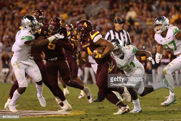 Running back Demario Richard of the Arizona State Sun Devils rushes the football past cornerback Tyree Robinson of the Oregon Ducks during the second...