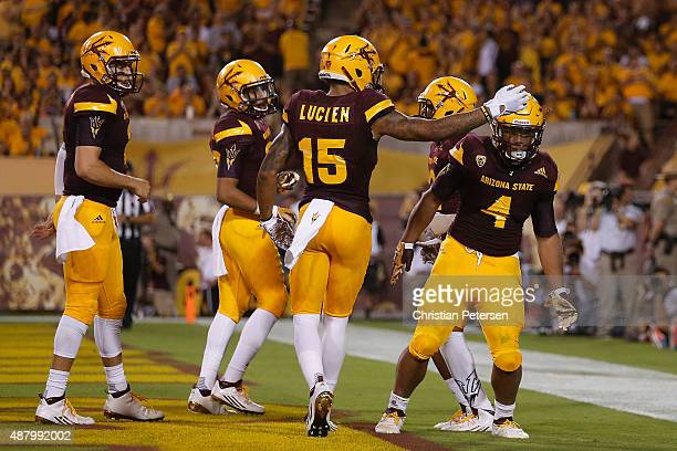 Running back Demario Richard of the Arizona State Sun Devils celebrates with wide receiver Devin Lucien after Richard scored on a six yard touchdown...