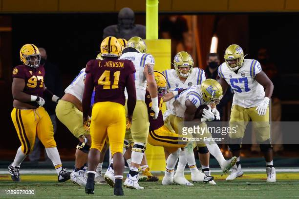 Running back Demetric Felton of the UCLA Bruins scores a 2-yard rushing touchdown against the Arizona State Sun Devils during the second half of the...