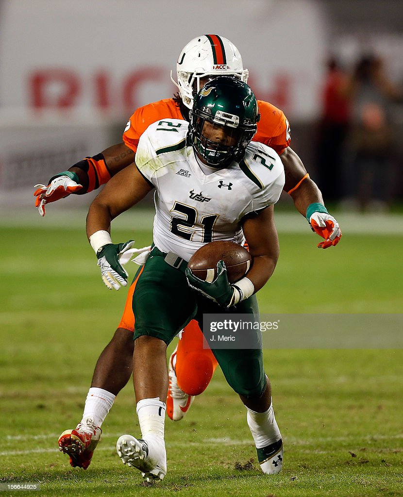 Running back Demetris Murray #21 of the South Florida Bulls runs the ball against the Miami Hurricanes during the game at Sun Life Stadium on November 17, 2012 in Miami Gardens, Florida.