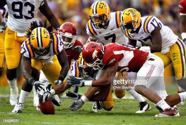 Running back Dennis Johnson of the Arkansas Razorbacks looses a fumble caused by cornerback Tyrann Mathieu of the LSU Tigers and it is recovered by...