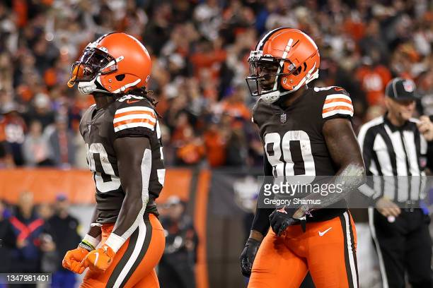 Running back D'Ernest Johnson of the Cleveland Browns celebrates with wide receiver Jarvis Landry after rushing for a first quarter touchdown against...