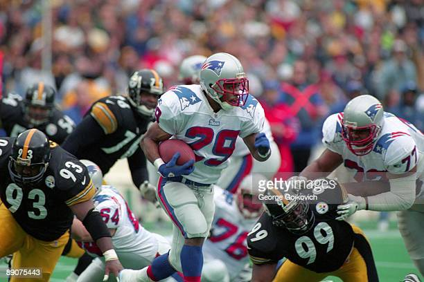 Running back Derrick Cullors of the New England Patriots runs the football against the Pittsburgh Steelers during a playoff game at Three Rivers...