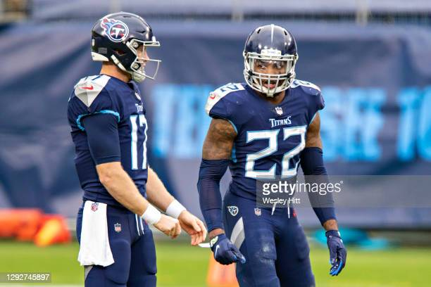 Running back Derrick Henry listens to the play from quarterback Ryan Tannehill of the Tennessee Titans during a game against the Detroit Lions at...