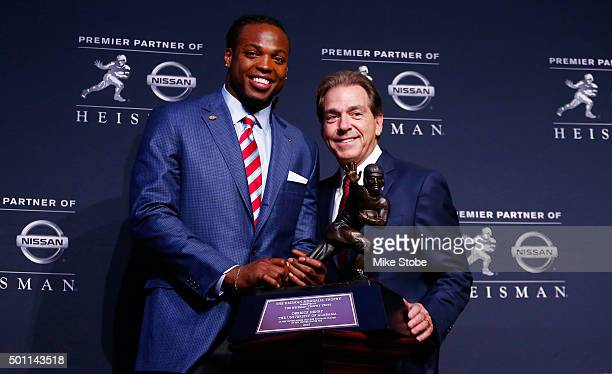 Running back Derrick Henry of the Alabama Crimson Tide poses with coach Nick Saban during a press conference after being named the 81st Heisman...