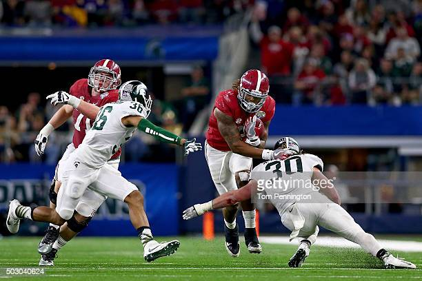 Running back Derrick Henry of the Alabama Crimson Tide runs the ball in the third quarter against the Michigan State Spartans during the Goodyear...