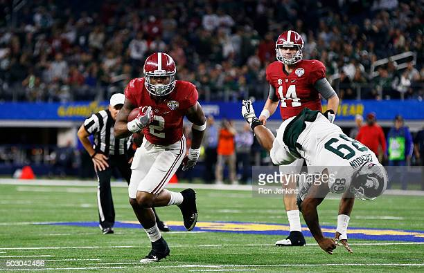 Running back Derrick Henry of the Alabama Crimson Tide stiff arms defensive end Shilique Calhoun and then runs for a touchdown in the fourth quarter...