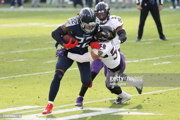 Running back Derrick Henry of the Tennessee Titans attempts to break a tackle from linebacker L.J. Fort of the Baltimore Ravens during the fourth...
