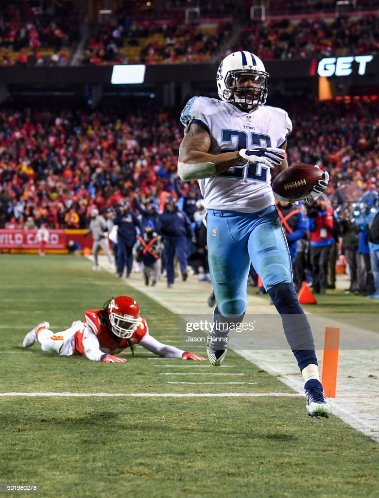 Running back Derrick Henry #22 of the Tennessee Titans breaks free from the tackle attempt of free safety Ron Parker #38 of the Kansas City Chiefs on his way to scoring a fourth quarter touchdown during the AFC Wild Card Playoff Game at Arrowhead Stadium on January 6, 2018 in Kansas City, Missouri.