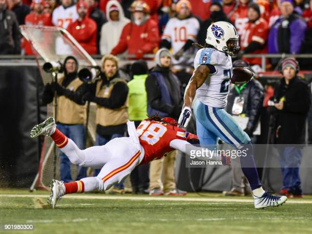 Running back Derrick Henry of the Tennessee Titans breaks free from the tackle attempt of free safety Ron Parker of the Kansas City Chiefs on his way...