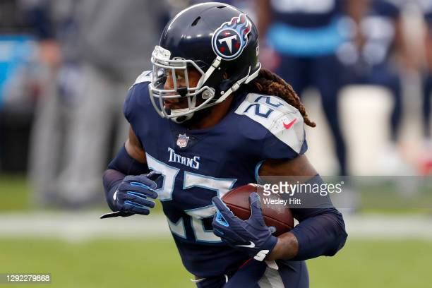 Running back Derrick Henry of the Tennessee Titans caries the football against the defense of the Detroit Lions during the first quarter of the game...