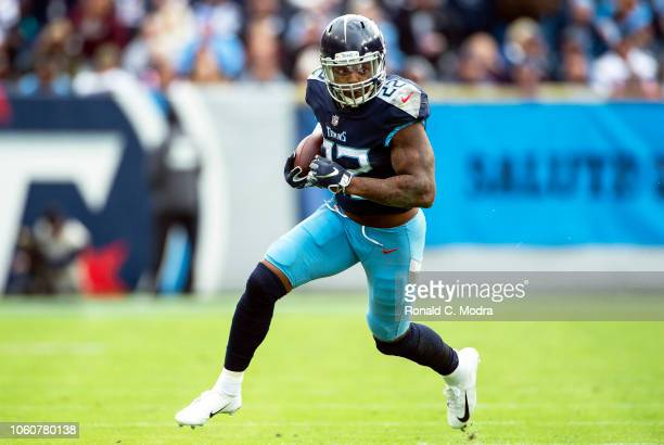 Running back Derrick Henry of the Tennessee Titans carries the ball during a NFL game against the New England Patriots at Nissan Stadium on November...