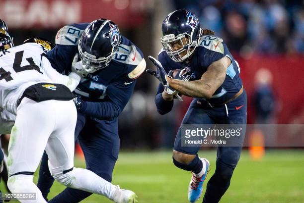 Running back Derrick Henry of the Tennessee Titans carries the ball against the Jacksonville Jaguars at Nissan Stadium on December 6 2018 in...