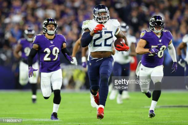 Running back Derrick Henry of the Tennessee Titans carries the ball against the Baltimore Ravens during the AFC Divisional Playoff game at M&T Bank...