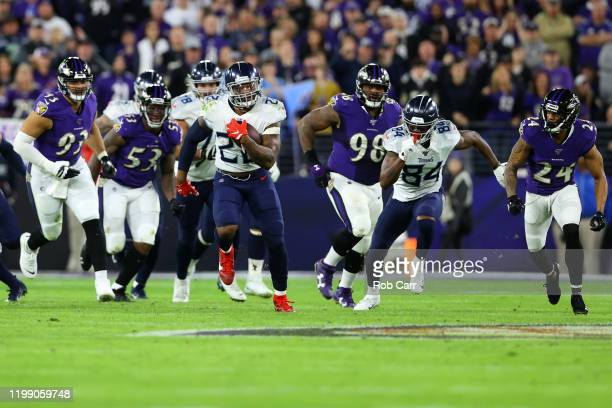 Running back Derrick Henry of the Tennessee Titans carries the ball against the Baltimore Ravens during the AFC Divisional Playoff game at MT Bank...