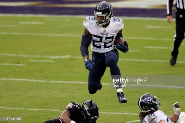 Running back Derrick Henry of the Tennessee Titans carries the ball against the Baltimore Ravens at M&T Bank Stadium on November 22, 2020 in...