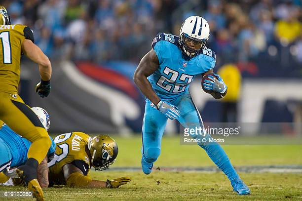 Running back Derrick Henry of the Tennessee Titans carries the ball during a NFL game against the Jacksonville Jaguars at Nissan Stadium on October...
