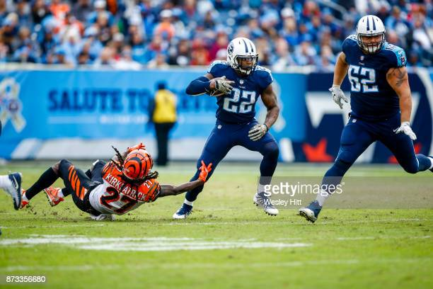 Running Back Derrick Henry of the Tennessee Titans carries the ball against Cornerback Dre Kirkpatrick of the Cincinnati Bengals at Nissan Stadium on...
