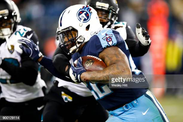 Running Back Derrick Henry of the Tennessee Titans carries the ball against Corner Back Aaron Colvin of the Jacksonville Jaguars at Nissan Stadium on...