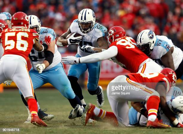 Running back Derrick Henry of the Tennessee Titans carries the ball during the game against the Kansas City Chiefs at Arrowhead Stadium on January 6...